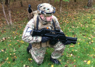 A person in camouflage with Laser-Tag Pulse Rifle and sensor